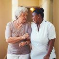 caregiver and a senior woman having conversation