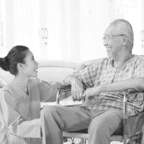 caregiver and a senior man having conversation